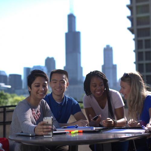 Group of students with city skyline in background